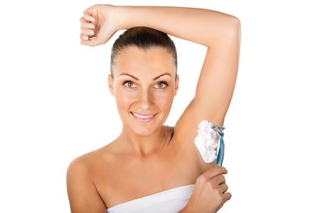 scincare: Female shaving underarm with razor