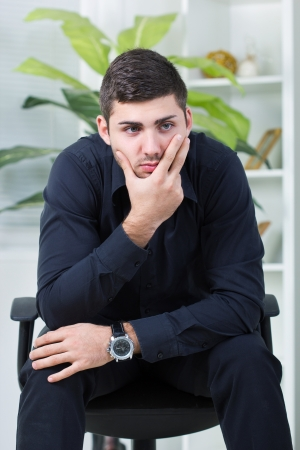 tense: depressed bussinesman worried  about too much work Stock Photo