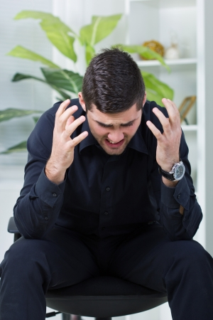 nervous businessman yelling, worried about job Stock Photo - 21879087