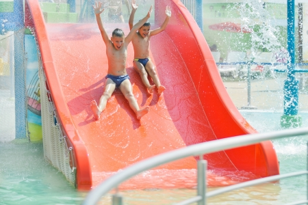 boys on water toboggan at aquapark photo