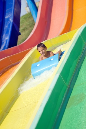 little boy in aquapark enjoys photo