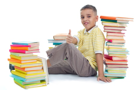 boy siting on floor surrrounded with books photo