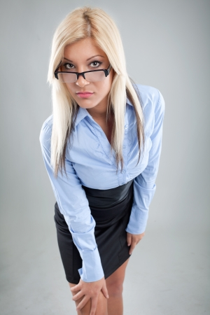 blond beautiful businesswoman with glasess standing photo