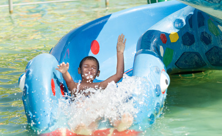 Boy having fun in aqua park photo