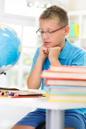 blonde boy: Blonde boy studying
