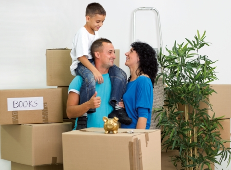 Happy smiling family moving photo