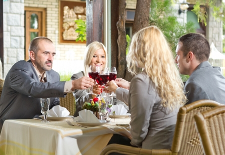 Two businesswoman and two businessman having lunch in restaurant photo