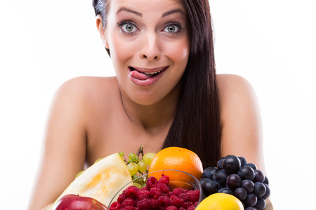 Beautiful woman with fresh fruit photo