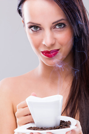 Beautiful woman drinking hot coffee Stock Photo - 22384853