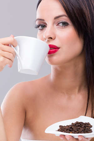 Woman drinking hot coffee at the morning photo