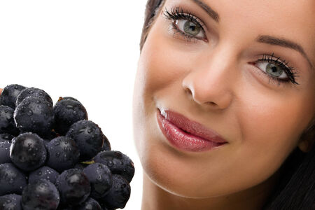 portrait of woman and fresh grapes photo