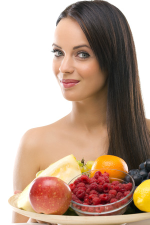 Beautifu youngl woman with fresh fruit photo