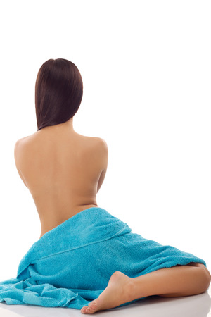 beautiful woman with blue spa towels on white background   photo