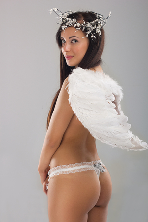 beautiful woman with angel wings standing photo