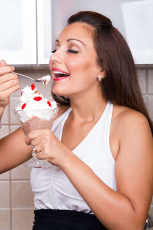young beautiful woman eating pudding