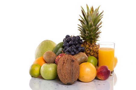 lots of fresh fruits and vegetables,and glass with orange juice photo