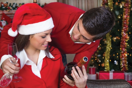 beautiful young couple celebrate Christmas night photo