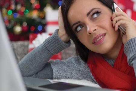 woman using mobile phone on Christmas Eve photo