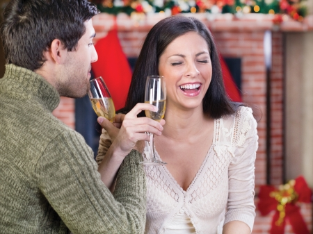 celebration champagne: couple holding glasses with champagne and celebrate Christmas night