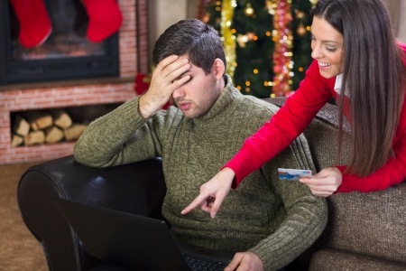 man covering his eyes with his hand because  the cost woman on Christmas night photo