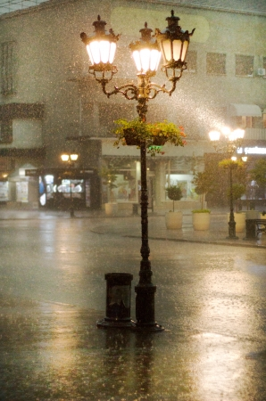 photo of an old street lamppost in the rain