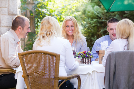 young business people at the lunch restaurant discussing photo