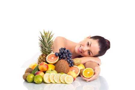 young healthy girl with a lot of fruit photo