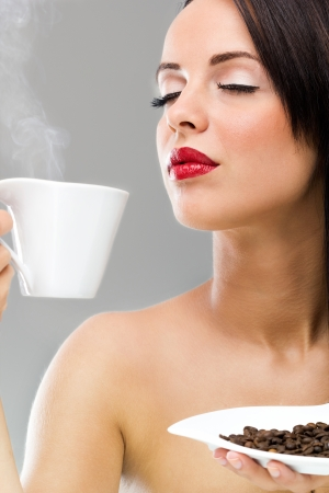Beautiful woman drinking hot coffee  photo