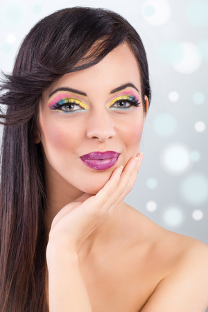 beautiful brunette model portrait,colorful make-up photo