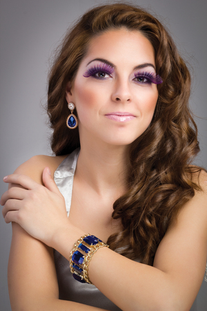beautiful brunette model portrait, purple make-up      photo