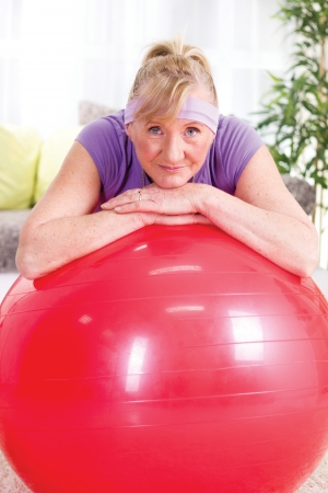 woman resting in fitness ball  photo