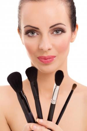 makeup brush: beautiful woman with make-up brushes