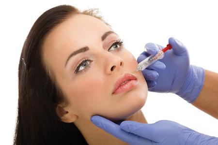 reg: Botox shot in the female cheek,close up