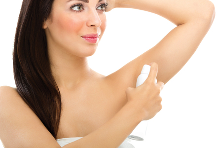 Portrait of girl applying underarm deodorant Stock Photo