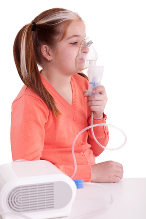 young little girl with pigtails  keeping inhale mask photo