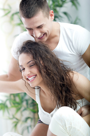 happy smiling young couple at home fooling around photo