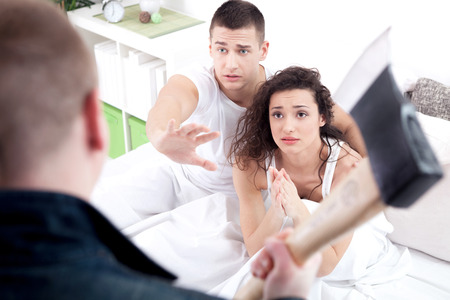 cheating: angry husband with hatchet caught cheating wife with lover