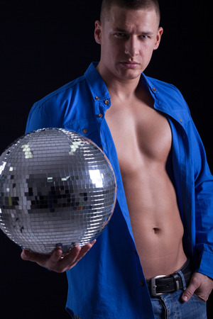 handsom: muscular handsom man holding a disco ball Stock Photo