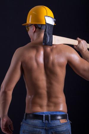 Ņhatchet: young muscular worker holding hatchet
