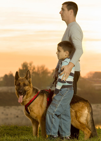 man,child, dog,in nature  photo