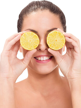 Portrait of a young woman getting funny with orange photo
