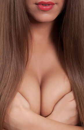 naked woman covering her big breast with hands  Imagens