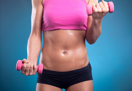 Fitness woman doing workout with weights photo
