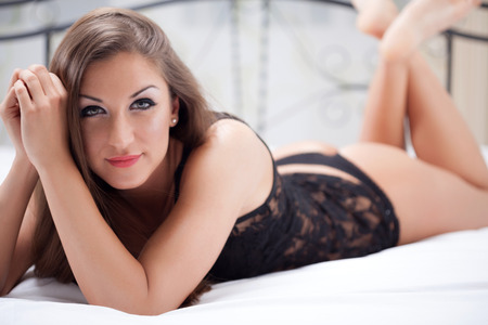 sexy elegant woman lying on the bed photo