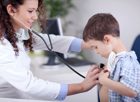 family practitioner: female doctor examining a little boy