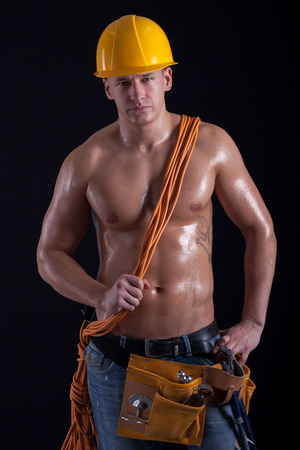 muscular male construction worker photo