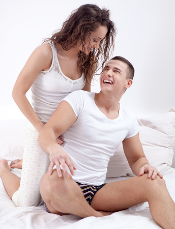 Young happy couple in love tickles photo