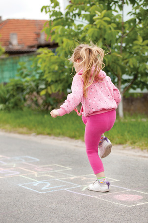 beautiful litlle girl on the hopscotch