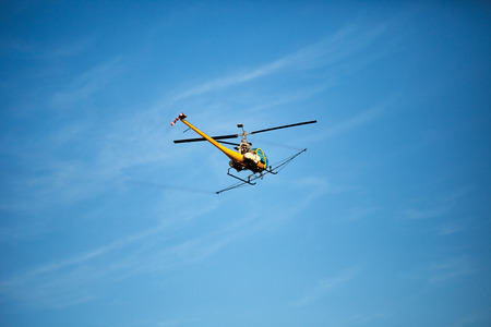 eradicate: Helicopter used for aerial applications (crop dusting) in flight