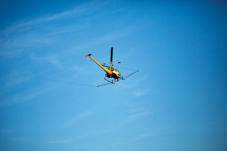 dusting: Helicopter used for aerial applications (crop dusting) in flight